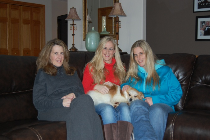As the photo shows, this mystery dog has brought a lot of joy to the lives of (from left) Christine Vlahakis and her nieces Amanda Johnson Feimer and Amy Johnson. The three women became concerned about the welfare of the dog after spotting it near the Vishay plant along Highway 50 in Yankton and were later able to capture it.